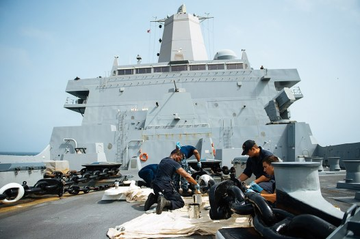 1280px-Sailors_aboard_USS_Anchorage_(LPD-23)_painting_the_forecastle_port_anchor_chain_(150706-N-BD107-118)